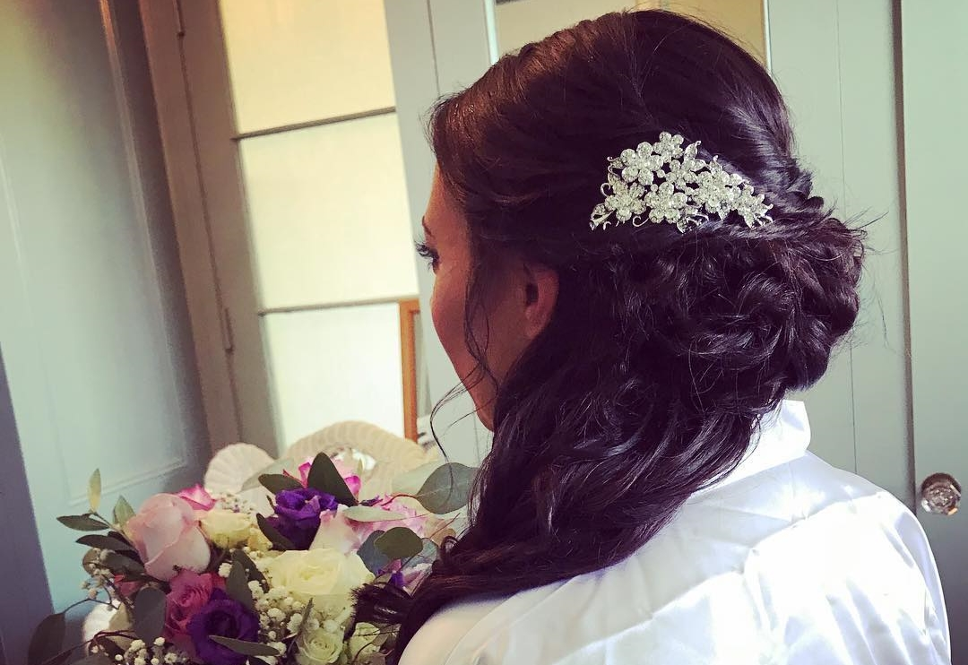 Side swept half updo for the bride